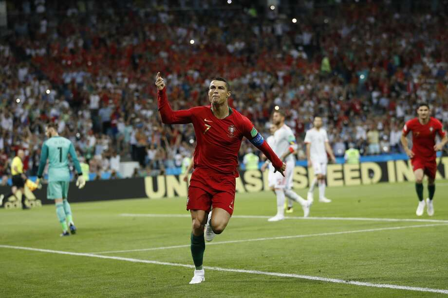 Portugal's Cristiano Ronaldo celebrates his side's opening goal during the group B match between Portugal and Spain at the 2018 soccer World Cup in the Fisht Stadium in Sochi, Russia, Friday, June 15, 2018. (AP Photo/Francisco Seco) Photo: Francisco Seco/Associated Press