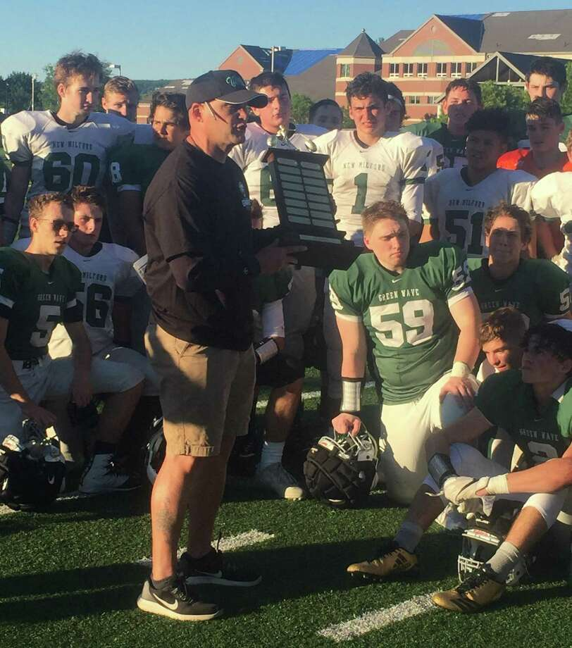 New Milford High School football coach Chuck Lynch awards the Joe South Memorial Trophy to the White Team at the conclusion of the annual Green and White Spring Football Game at New Milford High School June 15, 2018. Photo: Richard Gregory / Richard Gregory