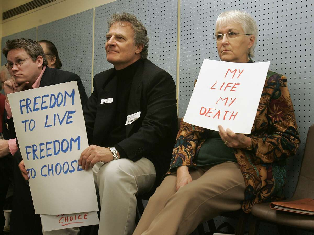 Stephen Jamison, of Cotati, center, and Janet Bowman Johnson, right, of Clayton, show their support for an assisted suicide measure introduced at a Capitol news conference in Sacramento, Calif., Thursday, Feb. 15, 2007. The bill, co-authored by Democratic Assembly members Lloyd Levine of Van Nuys, and Patti Berg, of Eureka, both unseen, is the third attempt by lawmakers to make California the second state in the country where doctors could give dying patients life-ending drugs. (AP Photo/Rich Pedroncelli) Ran on: 02-16-2007 Stephen Jamison (center) and Janet Bowman Johnson show their support for physician-assisted suicide at a Capitol news conference. ALSO Ran on: 04-08-2007 Advocates of assisted suicide support a new bill in February during a Capitol news conference in Sacramento. Others argue that the matter of choice will not be confined to the terminally ill.