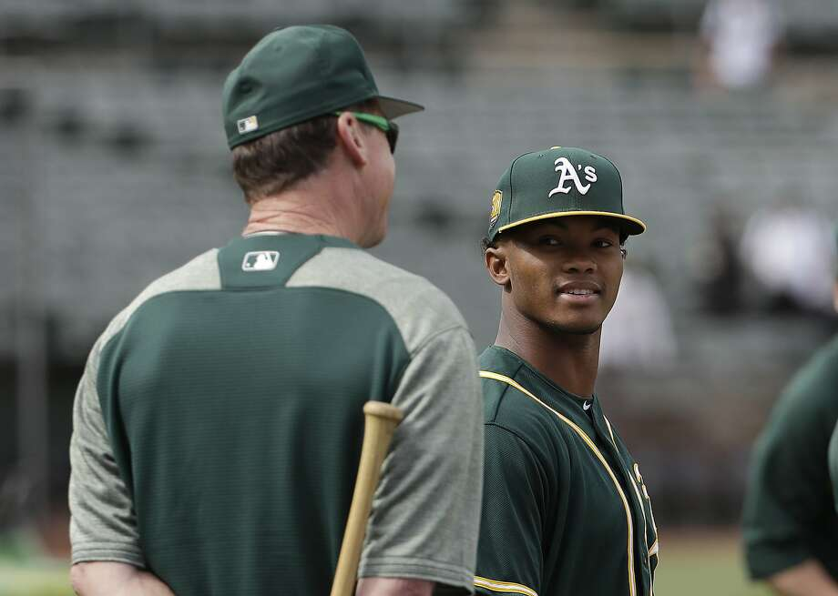 Oakland Athletics' Kyler Murray, right, talks with manager Bob Melvin during batting practice before a baseball game against the Los Angeles Angels in Oakland, Calif., Friday, June 15, 2018. (AP Photo/Jeff Chiu) Photo: Jeff Chiu / Associated Press