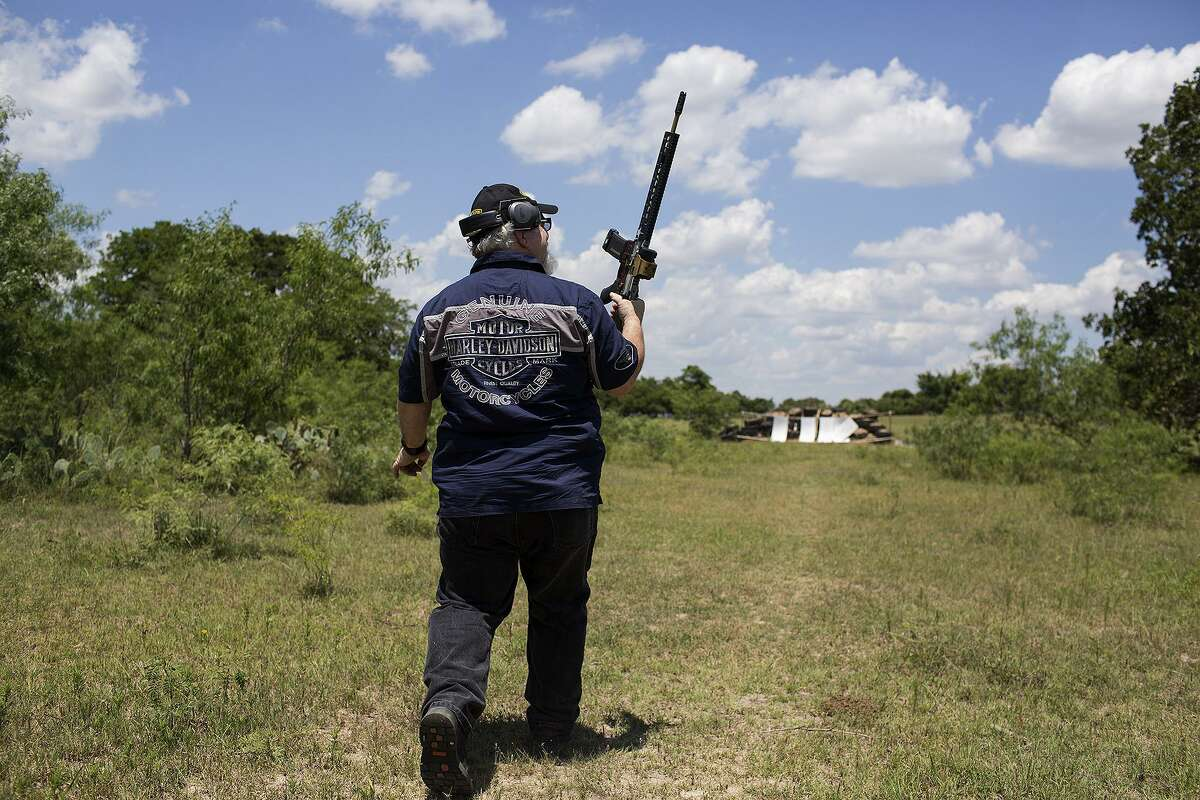 Stephen Willeford walks to shoot an AR-15 rifle specially made for him and gifted to him moments earlier by Stephen Oliver, a firearms manufacturer and dealer with Texas Rifle, for the first time at Willeford's property near Sutherland Springs on May 28, 2018.