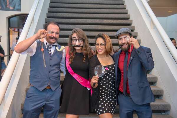 Visitors looked for clues in the various galleries to solve a murder mysteryat the San Antonio Museum of Art Friday night.