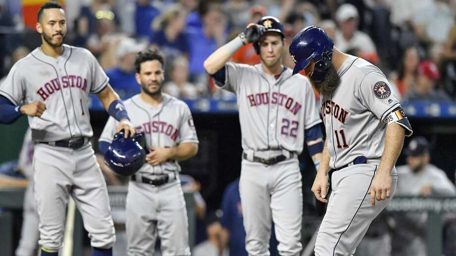 The Houston Astros' Evan Gattis steps on home after hitting a grand slam that also scored Carlos Correa, Jose Altuve and Josh Reddick in the sixth inning against the Kansas City Royals on Friday, June 15, 2018, at Kauffman Stadium in Kansas City, Mo. (John Sleezer/Kansas City Star/TNS) Photo: John Sleezer/TNS