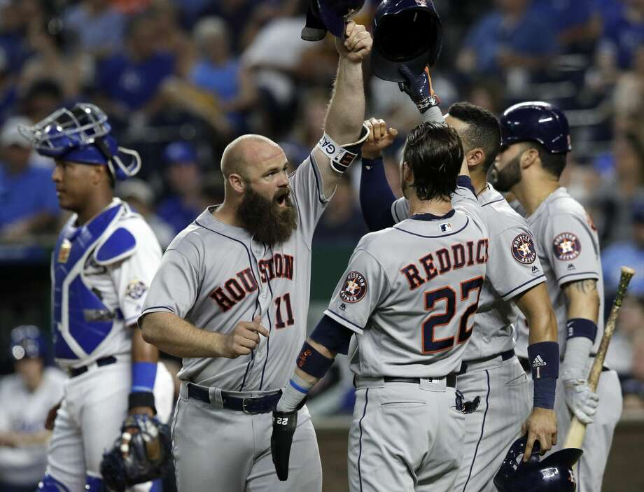 Houston Astros designated hitter Evan Gattis (11) celebrates his grand slam with teammates during the sixth inning of a baseball game against the Kansas City Royals at Kauffman Stadium in Kansas City, Mo., Friday, June 15, 2018. (AP Photo/Orlin Wagner) Photo: Orlin Wagner/Associated Press