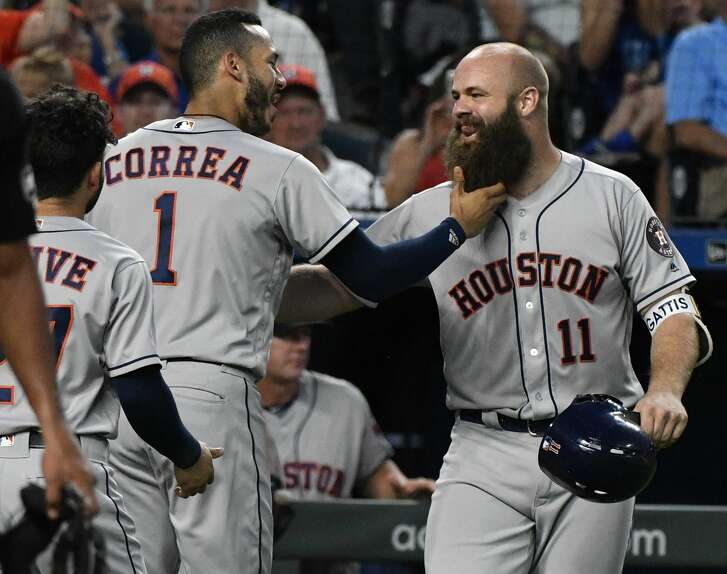 KANSAS CITY, MO - JUNE 15: Evan Gattis #11 of the Houston Astros celebrates his grand slam with Carlos Correa #1 in the sixth inning against the Kansas City Royals at Kauffman Stadium on June 15, 2018 in Kansas City, Missouri. (Photo by Ed Zurga/Getty Images)