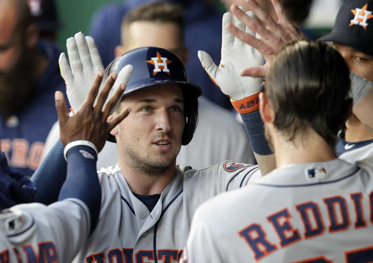 Houston Astros' Alex Bregman is congratulated by teammates after his solo home run off Kansas City Royals starting pitcher Jakob Junis during the fourth inning of a baseball game at Kauffman Stadium in Kansas City, Mo., Friday, June 15, 2018. (AP Photo/Orlin Wagner)