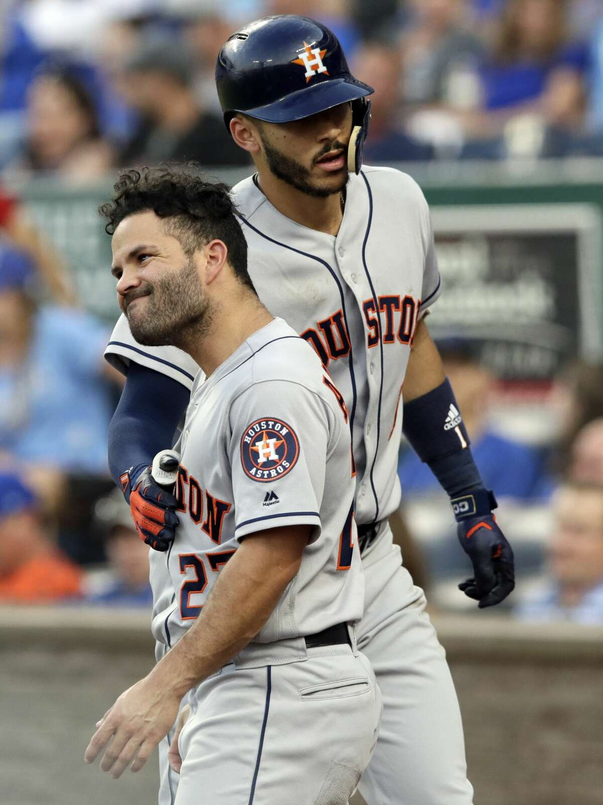 Houston Astros' Carlos Correa, right, is congratulated by teammate Jose Altuve (27) after his solo home run off Kansas City Royals starting pitcher Jakob Junis during the fourth inning of a baseball game at Kauffman Stadium in Kansas City, Mo., Friday, June 15, 2018. (AP Photo/Orlin Wagner)