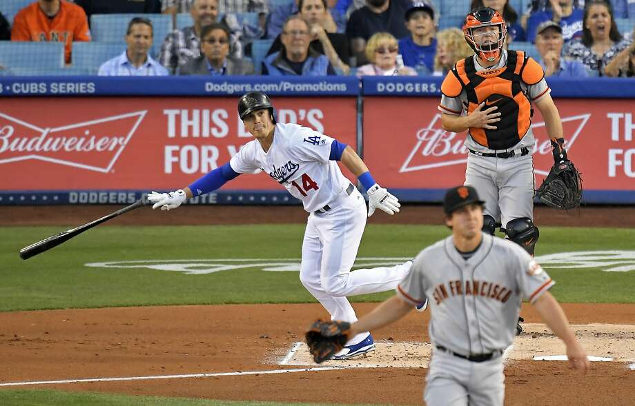 Los Angeles Dodgers' Enrique Hernandez, left, drops his bat after hitting a solo home run off San Francisco Giants starting pitcher Derek Holland, front, during the first inning of a baseball game Friday, June 15, 2018, in Los Angeles. (AP Photo/Mark J. Terrill) Photo: Mark J. Terrill / Associated Press