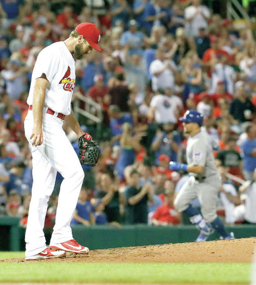 Cardinals starting pitcher Michael Wacha, left, walks back to the mound as Chicago Cubs' Kyle Schwarber rounds the bases after hitting a three-run home run in the fifth inning Friday night in St. Louis. Photo:       AP