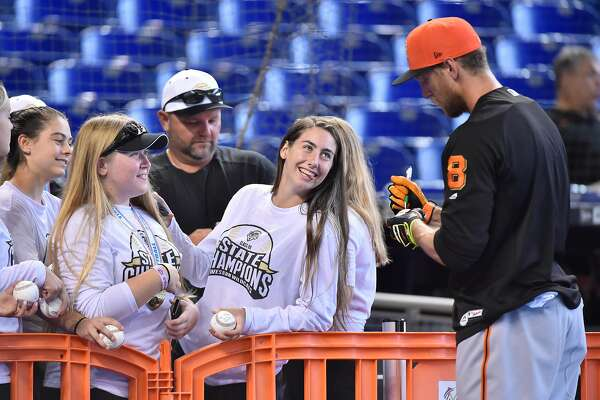 MIAMI, FL - JUNE 13: Hunter Pence #8 of the San Francisco Giants signs autographs for fans during batting practice before the start of the game against the Miami Marlins at Marlins Park on June 13, 2018 in Miami, Florida. (Photo by Eric Espada/Getty Images)