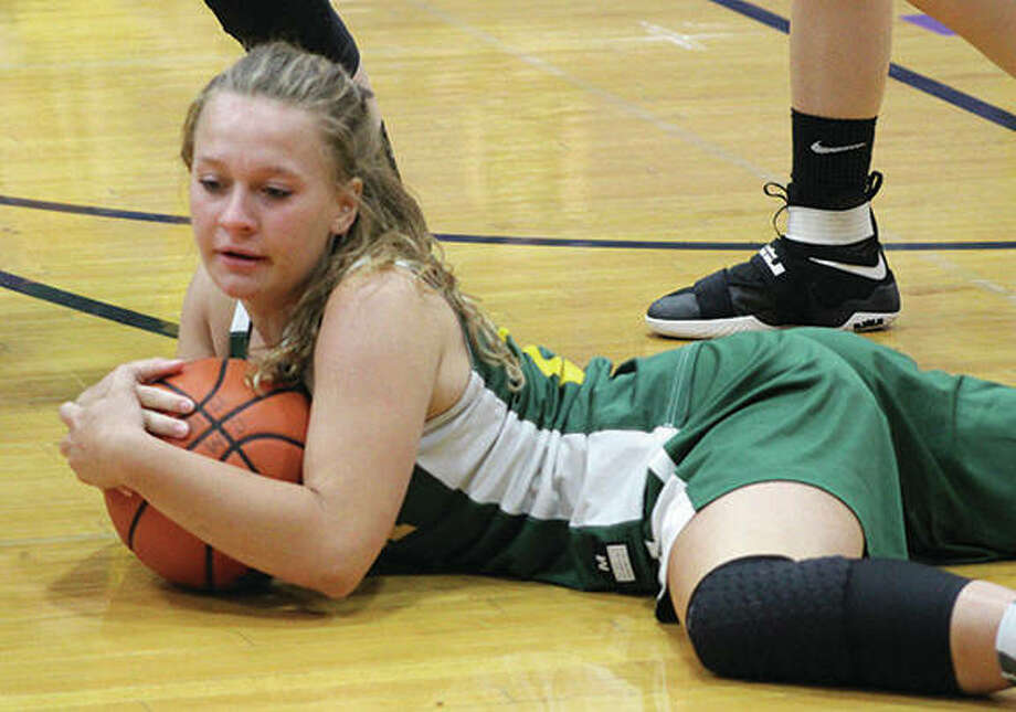 Southwestern's Natalie Keith covers a loose ball before a Piasa Birds timeout in a win over Marquette Catholic on Thursday at the CM Riverbend Shootout in Bethalto. Photo:       Greg Shashack / The Telegraph