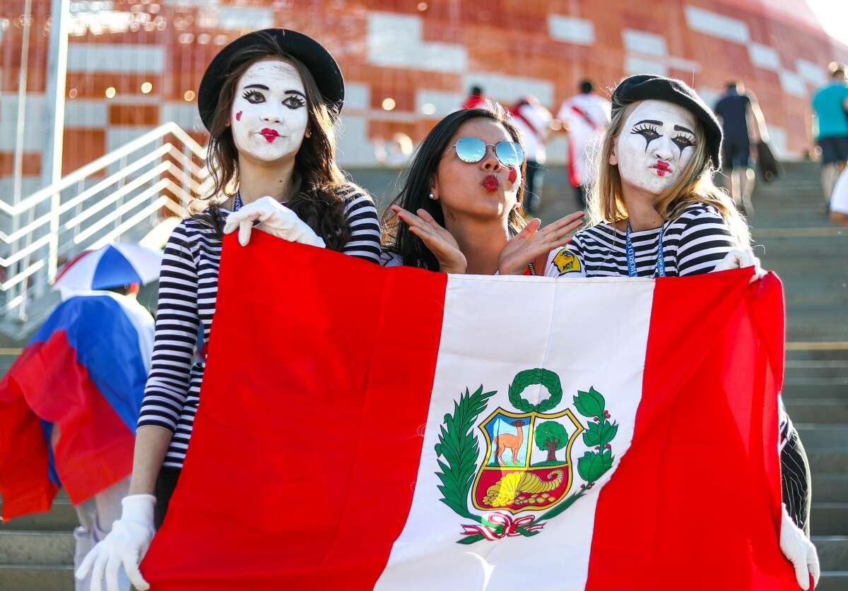 SARANSK, RUSSIA JUNE 16, 2018: Supporters of the Peruvian men's national football team waving a national flag outside Mordovia Arena Stadium ahead of the 2018 FIFA World Cup Group C match between Peru and Denmark. Stanislav Krasilnikov/TASS (Photo by Stanislav Krasilnikov\TASS via Getty Images)
