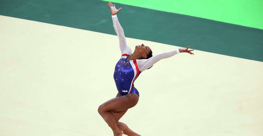 Simone Biles of the United States competes in the floor exercise during the womenâ??s gymnastics individual all-around final, at the 2016 Summer Olympics in Rio de Janeiro, Aug. 11, 2016. Biles won gold in the event; her teammate Aly Raisman took silver and Russia's Aliya Mustafina won bronze. (Chang W. Lee/The New York Times) Photo: CHANG W. LEE/NYT / NYT