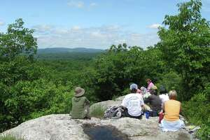FILE PHOTO — Some hikers catch a break at Millers Pond State Park in Durham.