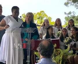Hillary Clinton with Wanda Holland Greene (left), head of the Hamlin School, at graduation.