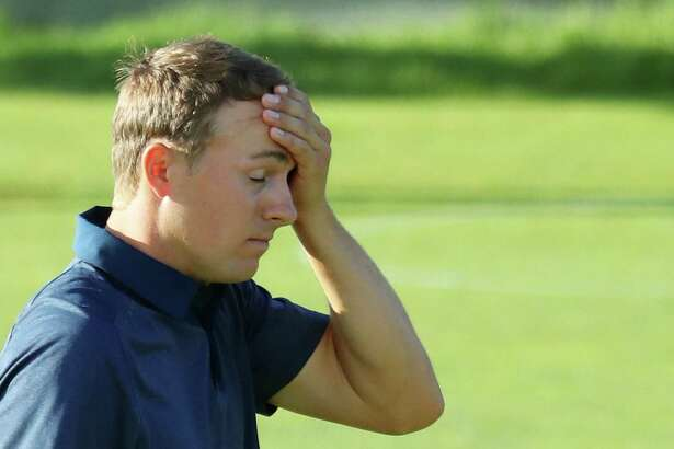 SOUTHAMPTON, NY - JUNE 15:  Jordan Spieth of the United States reacts after a missed put on the 18th green during the second round of the 2018 U.S. Open at Shinnecock Hills Golf Club on June 15, 2018 in Southampton, New York.  (Photo by Warren Little/Getty Images)
