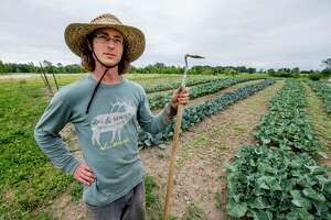 Field manager Byron Norsworthy prepares to do some weeding at 9 Miles East Farm's food distribution business June 13, 2018 in Northumberland, N.Y.  (Skip Dickstein/Times Union)
