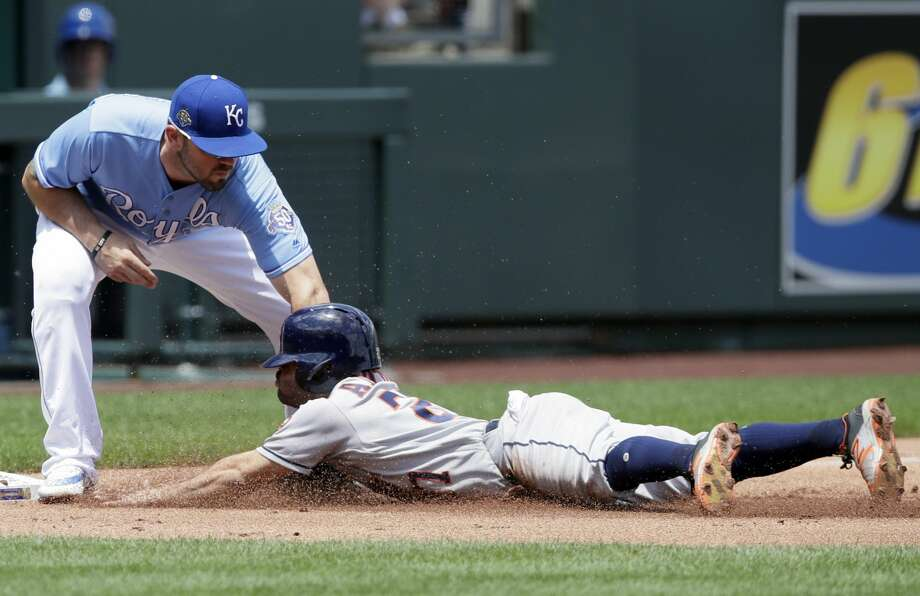 Houston Astros' Jose Altuve (27) is tagged out while trying to advance on a sacrifice fly by Kansas City Royals third baseman Mike Moustakas (8) during the first inning of a baseball game at Kauffman Stadium in Kansas City, Mo., Saturday, June 16, 2018. (AP Photo/Orlin Wagner) Photo: Orlin Wagner/Associated Press