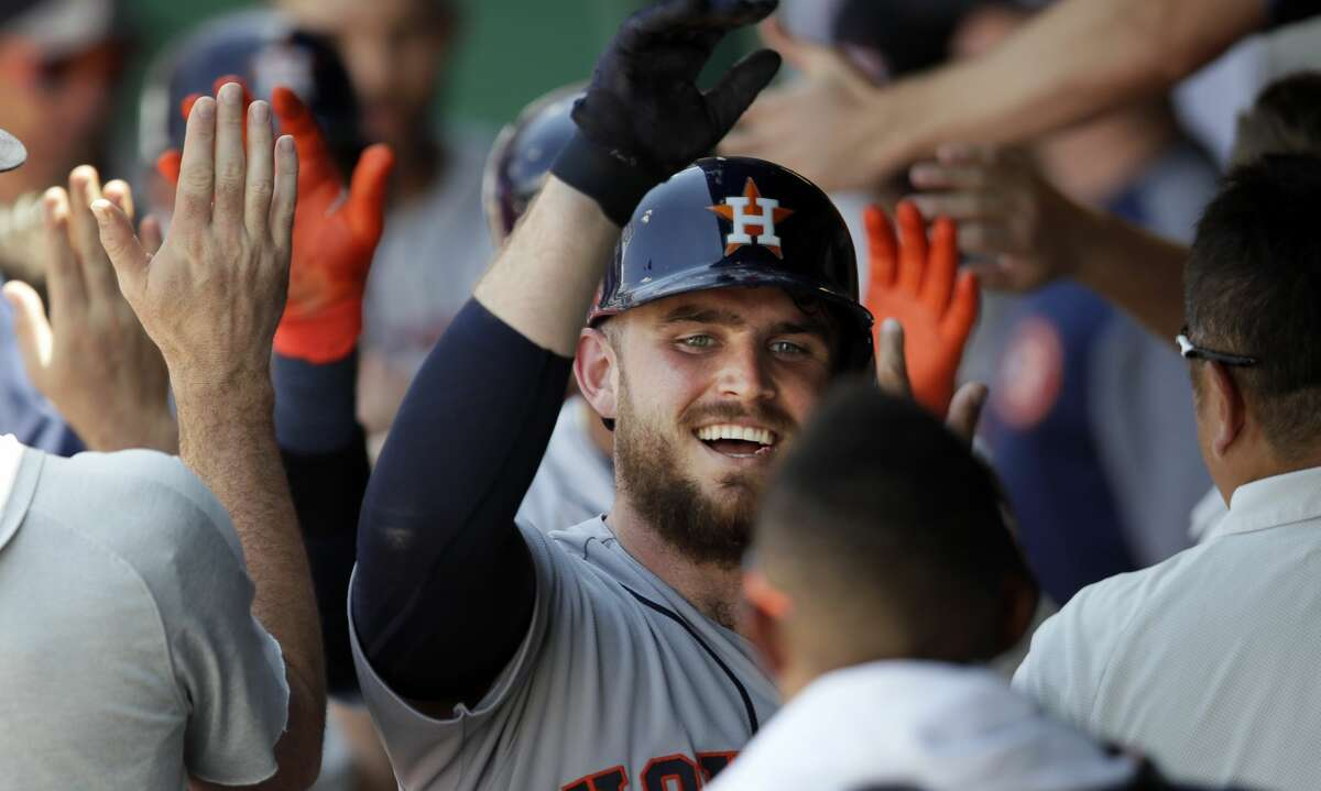 Houston Astros' Max Stassi celebrates with teammates after hitting a three-run home run during the sixth inning of a baseball game against the Kansas City Royals at Kauffman Stadium in Kansas City, Mo., Saturday, June 16, 2018. (AP Photo/Orlin Wagner)