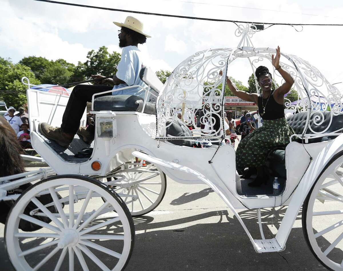 Olympic bobsledder Seun Adigun waves to the crowd during the annual Juneteenth Parade in Acres Homes, Saturday, June 16, 2018, in Houston. ( Karen Warren / Houston Chronicle )