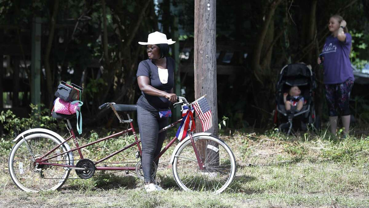 A woman with her decorated bicycle on the parade route during the annual Juneteenth Parade in Acres Homes, Saturday, June 16, 2018, in Houston. ( Karen Warren / Houston Chronicle )