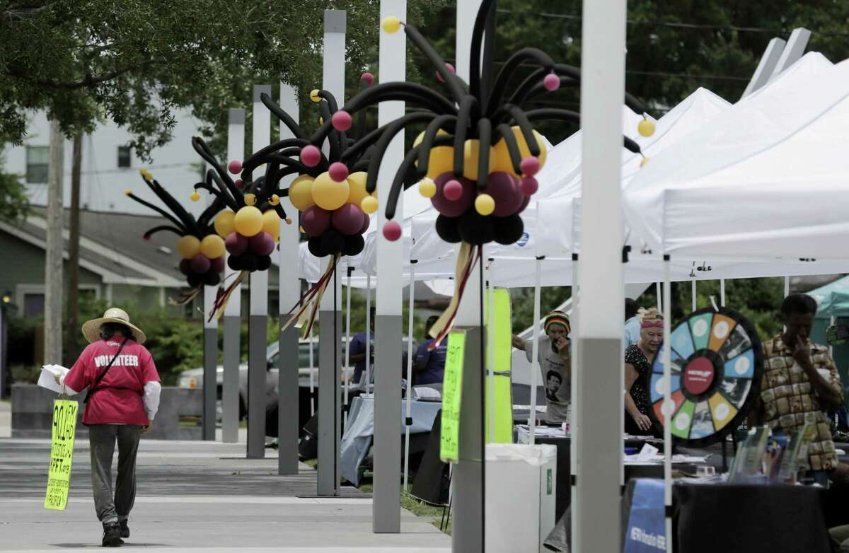 Information tents line the walkway during the Juneteenth Celebration at Emancipation Park hosted by the city of Houston and Emancipation Park Conservancy on Saturday, June 16, 2018 in Houston. The park is part of the Emancipation Avenue economic corridor. (Elizabeth Conley/Houston Chronicle)