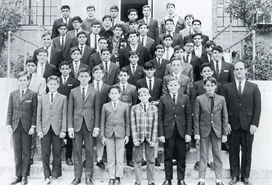 Brother Philip Richard Degagne poses with students at St. Joseph's Academy in 1966, where he served as a teacher, student council moderator, bus dirver and basketball coach. Photo: Courtesy Photo
