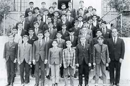Brother Philip Richard Degagne poses with students at St. Joseph's Academy in 1966, where he served as a teacher, student council moderator, bus dirver and basketball coach.