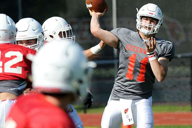 Team White quarterback Gavin Muir throws a pass during Greenwich's annual Red-White scrimmage on Saturday.