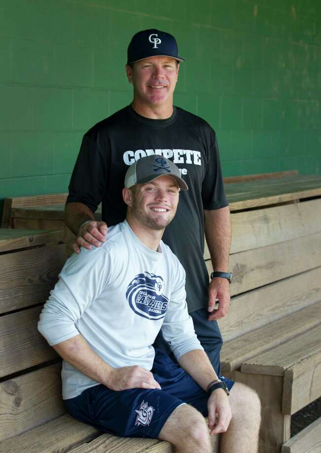 Travis Washburn poses for a portrait with his father and College Park head coach Jason Washburn on Thursday, May 31, 2018, in The Woodlands. Photo: Jason Fochtman, Staff Photographer / Houston Chronicle / © 2018 Houston Chronicle