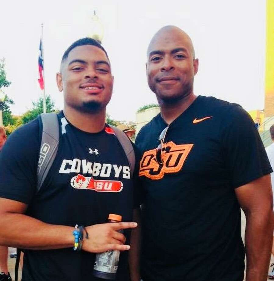 Conroe football coach Cedric Hardeman, right, poses for a photo with his son Chris Hardeman during Chris' time at Oklahoma State.