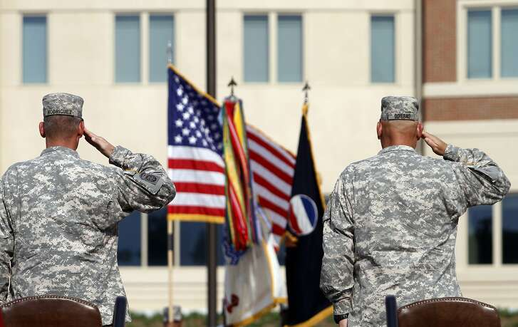 FILE - In this Sept. 12, 2011 file photo, generals salute during an installation ceremony at the U.S Army Forces Command at Fort Bragg, N.C., one the Army's three major command headquarters. The Army is scouting large cities in 2018 to find a home for a fourth command headquarters, one that would be near experts in technology and innovation who can help focus on the Army's future. The site is expected to be announced by the end of June 2018. (AP Photo/Jim R. Bounds, File)
