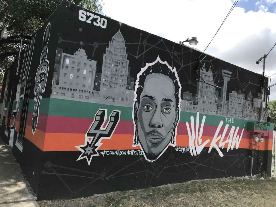 Countdown City Cuts barbershop in San Antonio sports a mural of Spurs star Kawhi Leonard. Countdown owner Steven Castilleja said he doesn't believe reports of Leonard seeking a trade from the Spurs, and won't take down the mural. Photo: René A. Guzman /San Antonio Express-News