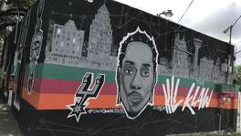 Countdown City Cuts barbershop in San Antonio sports a mural of Spurs star Kawhi Leonard. Countdown owner Steven Castilleja said he doesn't believe reports of Leonard seeking a trade from the Spurs, and won't take down the mural.