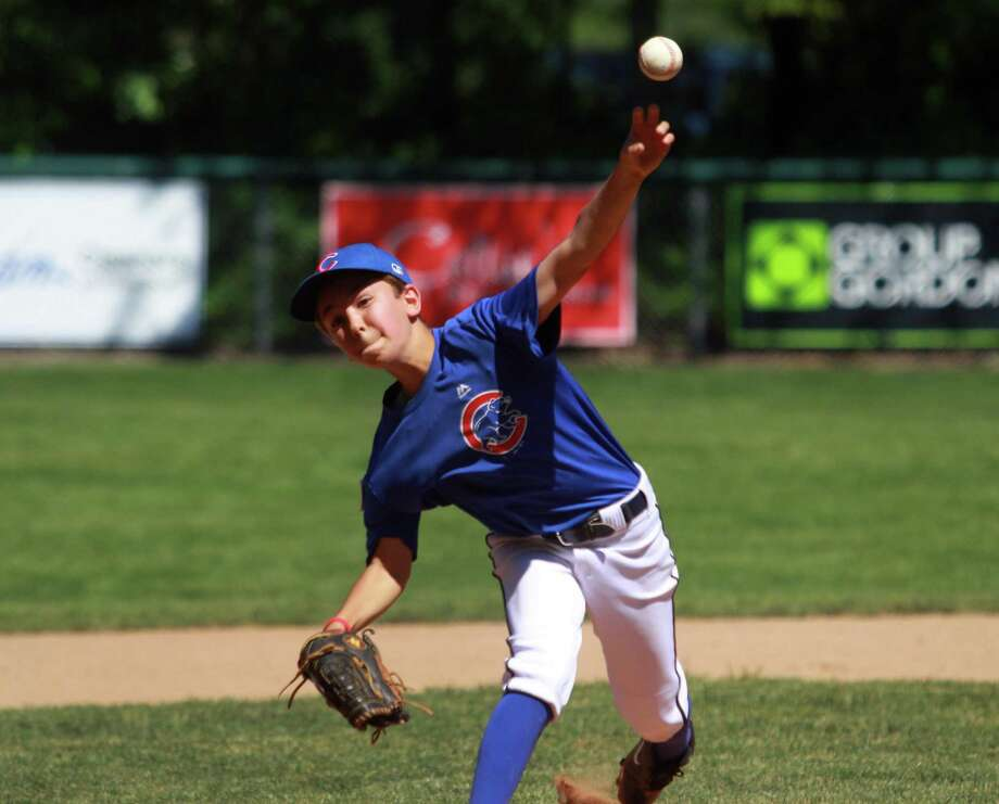 The Cubs' Connor Neill pitches against the Tigers during Westport Little League Baseball game action at Kowalski Field in Westport, Conn., on Saturday June 16, 2018. Kelly's teammate Perrin Delorey, whose jersey was retired in a ceremony before the game, died after a car accident last week. Instead of playing the scheduled championship game today, the team decided to play short three inning games with several other teams in the league. Photo: Christian Abraham / Hearst Connecticut Media / Connecticut Post