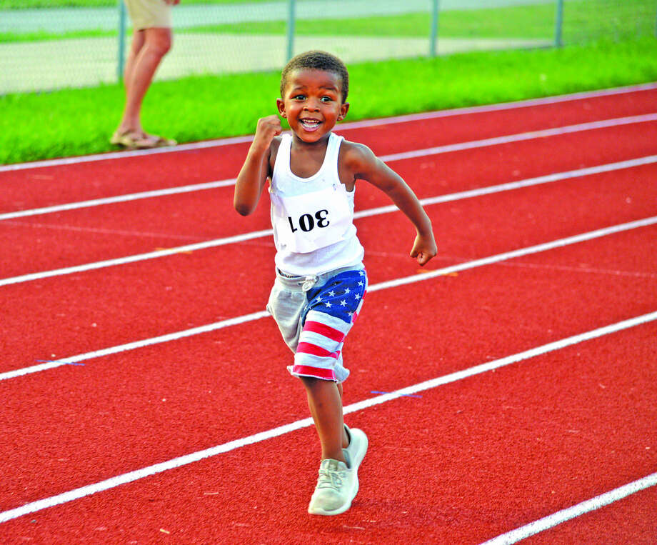 Jakhi Jones of Edwardsville, who is 3 1/2, competes in the 200-meter dash last Friday at the Friday Night Lights meet at the Winston Brown Track and Field Complex.