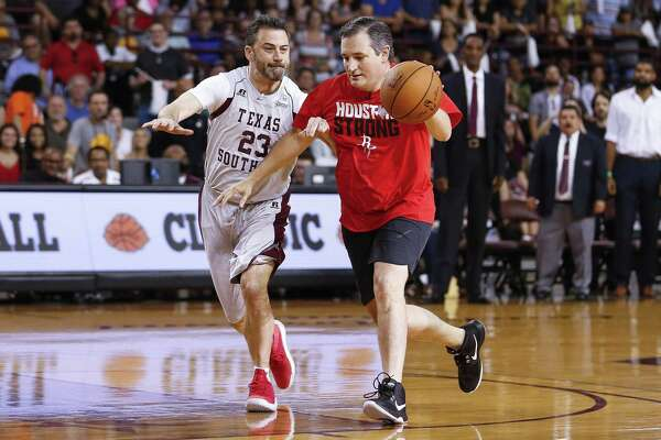 Senator Ted Cruz dribbles past Jimmy Kimmel during the Blobfish Basketball Classic and one-on-one interview at Texas Southern University's Health & Physical Education Arena Saturday, June 16, 2018 in Houston. Cruz challenged Kimmel to the game after Kimmel blamed the Houston Rockets playoff loss on the senator. (Michael Ciaglo / Houston Chronicle)