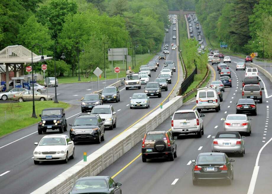 Dispite the limited trains into New York City traffic southbound on the Merritt Parkway at exit 46 was heavy but moving at 7:45 am. Photo: Cathy Zuraw / Cathy Zuraw / Connecticut Post