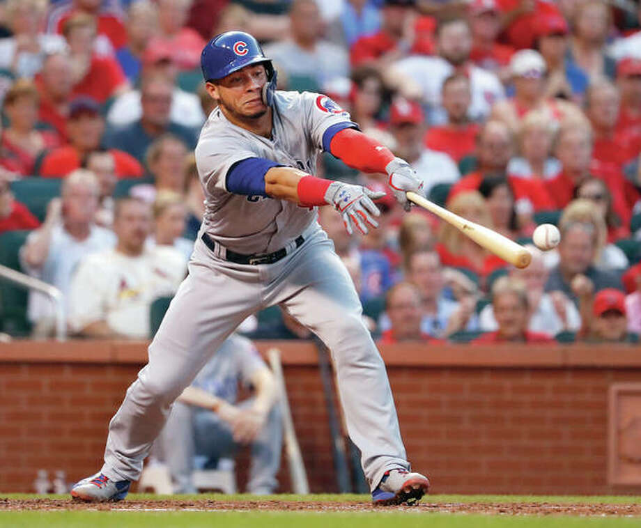 The Cubs' Willson Contreras hits a RBI single during the third inning against the Cardinals on Saturday night at Busch Stadium. Photo:       Associated Press