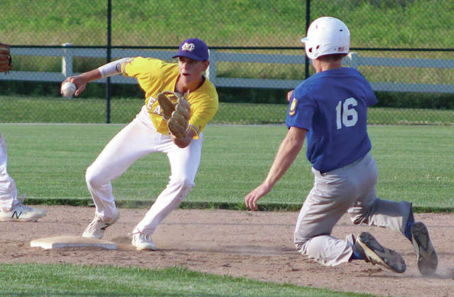 Civic Memorial second baseman Eli Smock (left) takes the throw before tagging out Jerseyville Legion's John Collins on a stolen base attempt during Wednesday at the Bethalto Sports Complex. Photo:       Greg Shashack / The Telegraph
