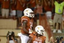 04 September 2016: Texas RB D'Onta Foreman (33) and brother Armanti (3) celebrate a TD during 50 - 47 win over Notre Dame at Darrell K. Royal - Texas Memorial Stadium in Austin, TX. (Photo by John Rivera/Icon Sportswire via Getty Images)
