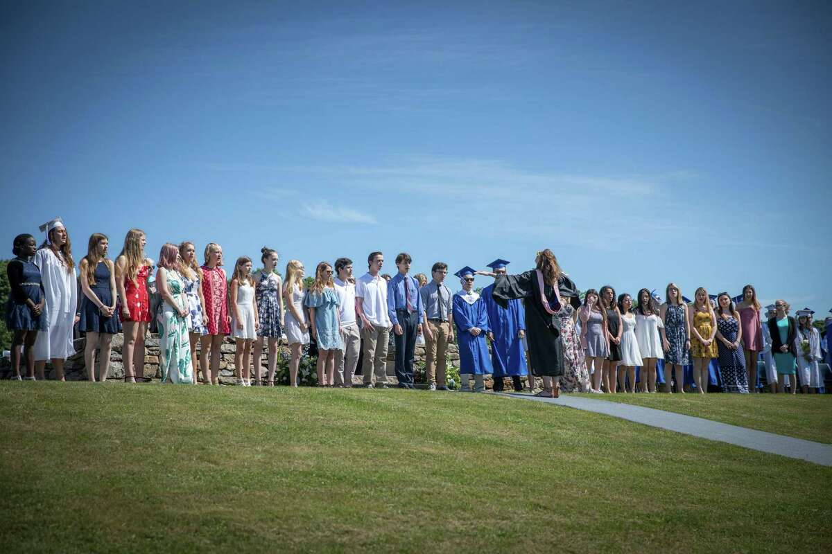 The Shepaug Chorus sings the National Anthem, directed by Beth Harvison, during the Shepaug Valley High School Class of 2018 Commencement on Saturday, June 16, 2018.