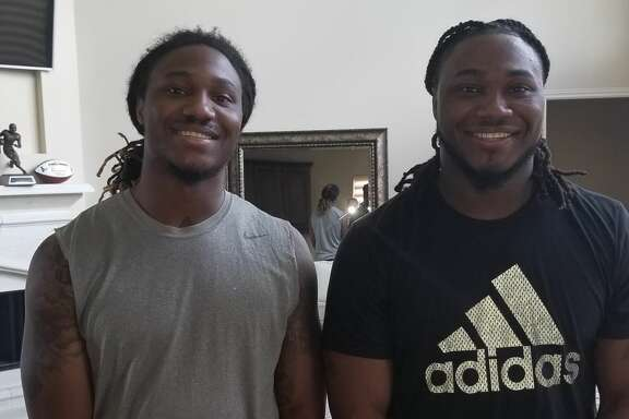 Texans running back D'Onta Foreman (right) with his brother Armanti.