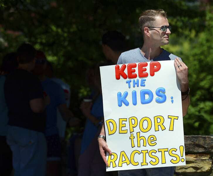 FILE - In this June 15, 2018 file photo, Chris Olson, of Lake Wallenpaupack, Pa., holds a sign outside Lackawanna College where U.S. Attorney Jeff Sessions spoke on immigration policy and law enforcement actions, in Scranton, Pa. The Trump administration's move to separate immigrant parents from their children on the U.S.-Mexico border has turned into a full-blown crisis in recent weeks, drawing denunciation from the United Nations, Roman Catholic bishops and countless humanitarian groups. (Butch Comegys/The Times-Tribune via AP, File)