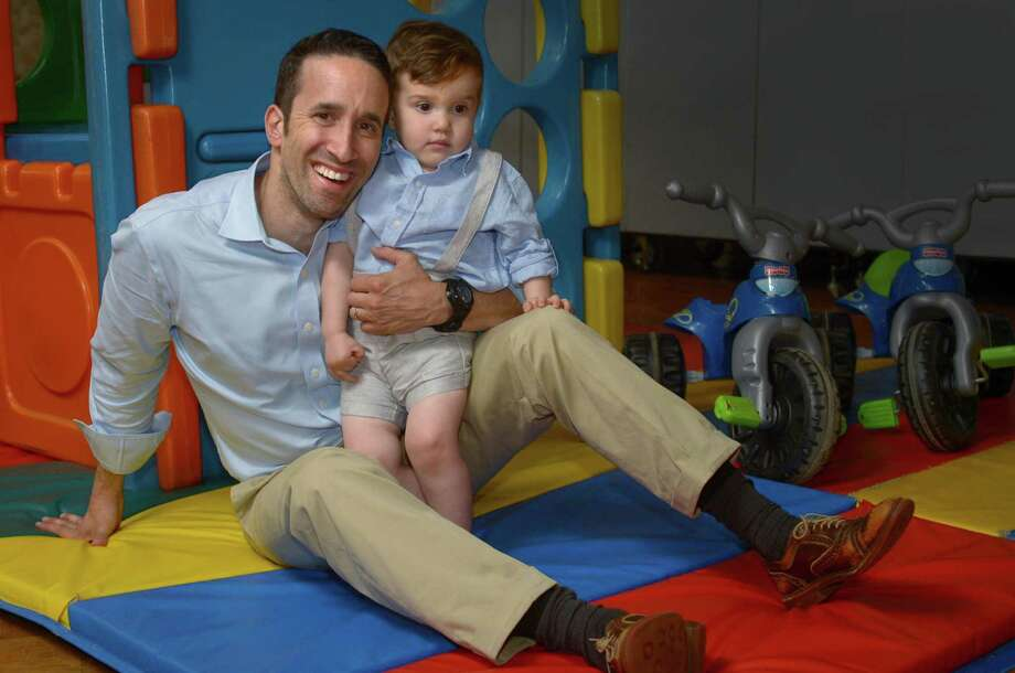 Craig Oshrin, and his 22-month-old son, Jacob, pose for a photo on Wednesday, June 13, 2018, at Jacob's daycare center at Temple Shalom in Norwalk, Conn. Photo: Erik Trautmann / Hearst Connecticut Media / Norwalk Hour