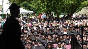 Graduates watch as a fellow graduate walks across the stage to receive his diploma during the Union College 224th Commencement Exercises on Sunday, June 17, 2018, in Schenectady, N.Y.   (Paul Buckowski/Times Union)