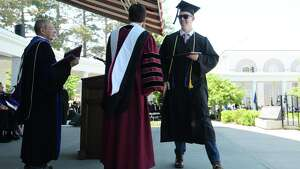 Graduate Michael Adams, right, receives his diploma from President Stephen Ainlay during the Union College 224th Commencement Exercises on Sunday, June 17, 2018, in Schenectady, N.Y.   (Paul Buckowski/Times Union)