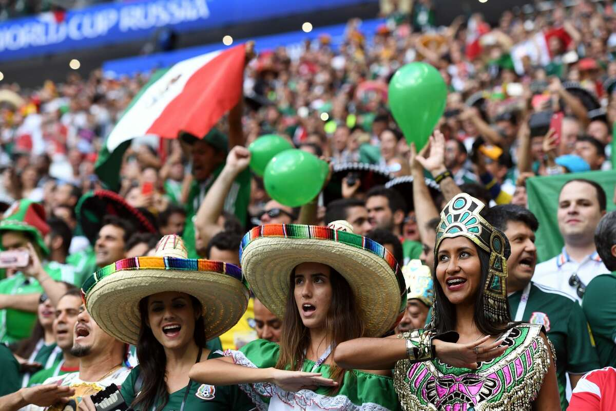 Mexico fans celebrate at the end of the Russia 2018 World Cup Group F football match between Germany and Mexico at the Luzhniki Stadium in Moscow on June 17, 2018. (Photo by Kirill KUDRYAVTSEV / AFP) / RESTRICTED TO EDITORIAL USE - NO MOBILE PUSH ALERTS/DOWNLOADS (Photo credit should read KIRILL KUDRYAVTSEV/AFP/Getty Images)
