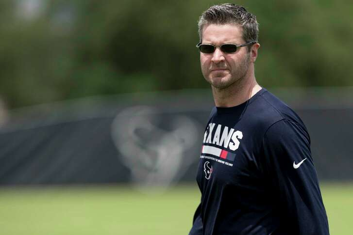 Houston Texans general manager Brian Gaine walks onto the practice field for rookie mini camp at The Methodist Training Center on Friday, May 11, 2018, in Houston.