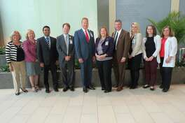 Members of the award-winning Bridgeport Hospital clinical redesign team  with hospital leaders, including William M. Jennings, president and CEO  (fourth from right).